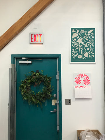 a wreath, a calendar, and a fantastic plants print