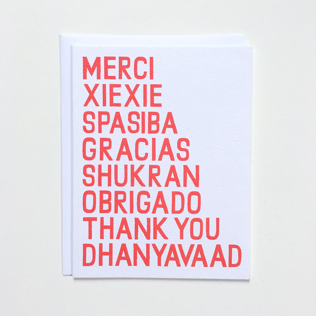 Thank you in eight different languages on a notecard