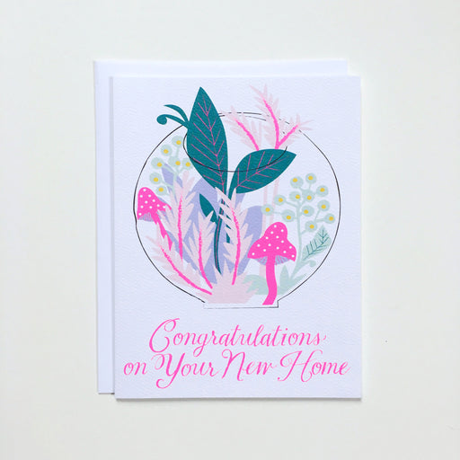 Plant filled terrarium on a happy housewarming card.