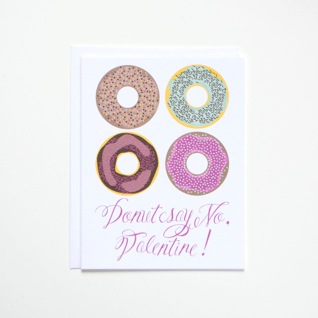 A note card with 4 donuts on it with script that Donut Say No Valentine for your love on Valentine's Day