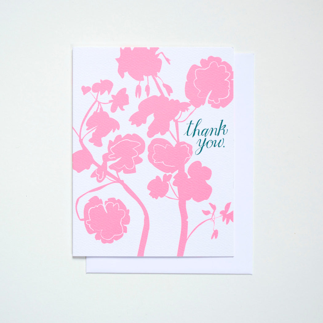 Pastel neon geranium or pelargonium with a dark green Thank You. A note card from Banquet Workshop.