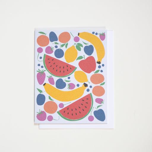 Lots of fruit on this note cards including watermelon slices, bananas, lemons, cherries, and tangerines