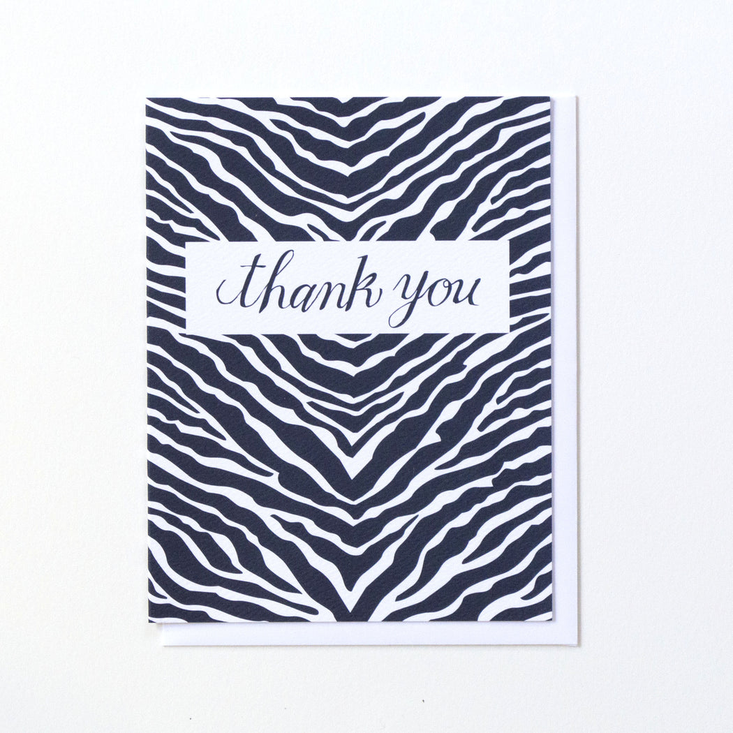 navy blue zebra stripe back ground with Thank You written in script