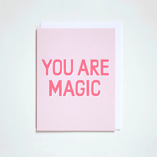 "Banquet Workshop's graphic neon pink on blush pastel notecard read's ""You Are Magic"""