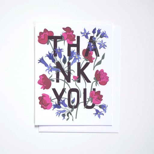 Note Card with a graphic Thank You and a mix of raspberry ranunculus and baby blue blooms.