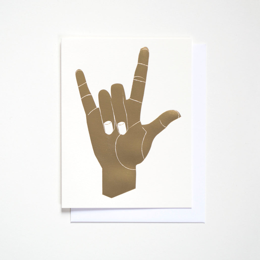 "Banquet Workshop notecard with a gold foil hand making the ""I Love You"" gesture."