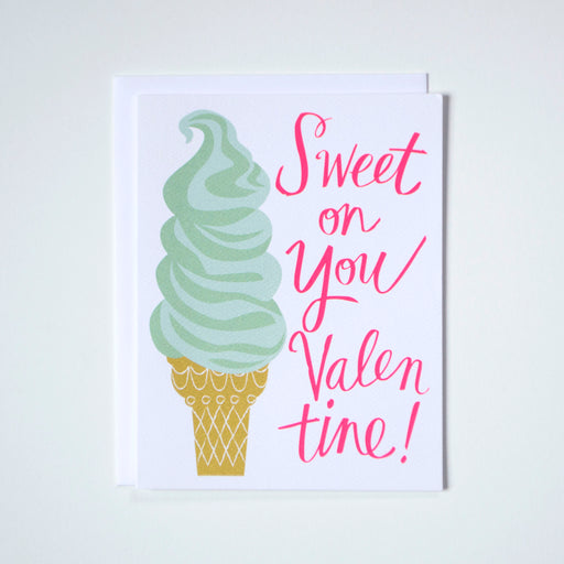 "A note card with a drawing of a soft serve ice cream and a neon pink message reading ""Sweet on You Valentine!"""
