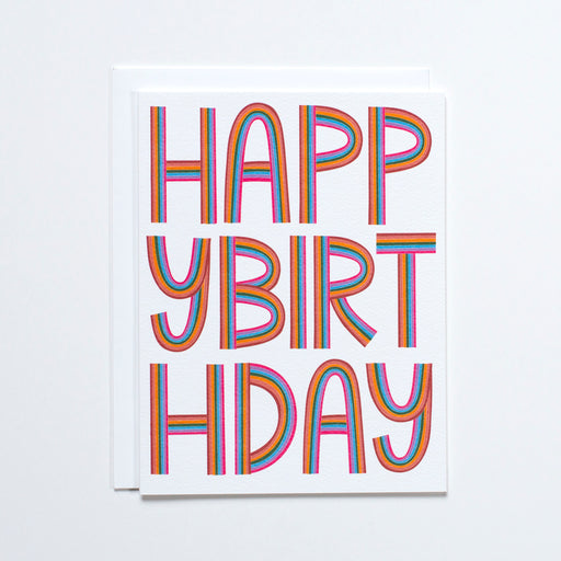Rainbow striped type reads Happy Birthday on this recycled paper note card