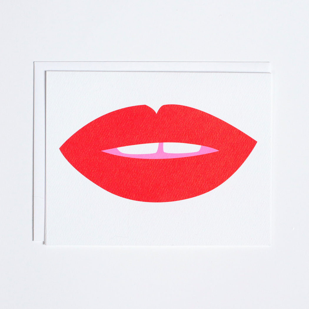 Note Card with a pair of bright red lips, and gap-toothed kiss coming your way