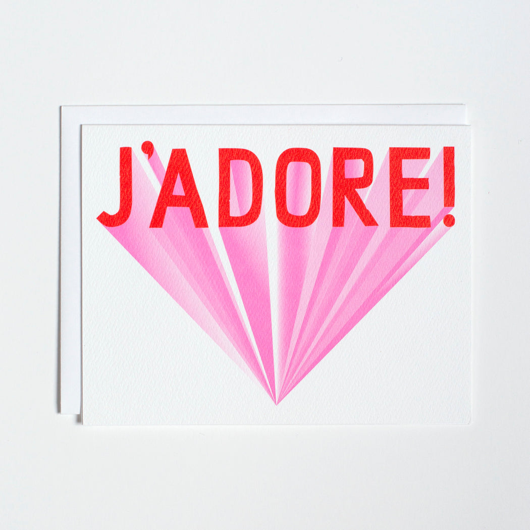 Red type on a blank Note Card reads J'Adore!