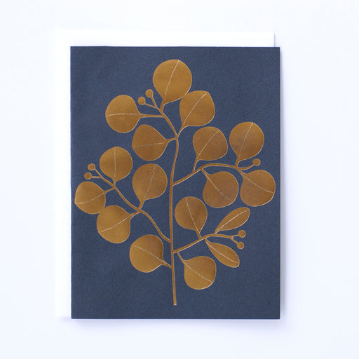 golden foiled leaves on navy note card