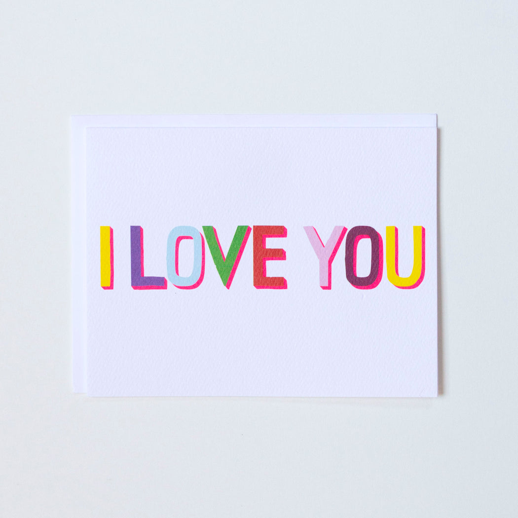 Bold I Love You type ini many colours with a hit of neon around the edges of the typeface