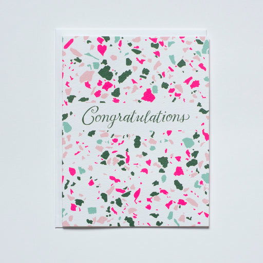 "neon pink and green terrazzo card reads ""congratulations"""