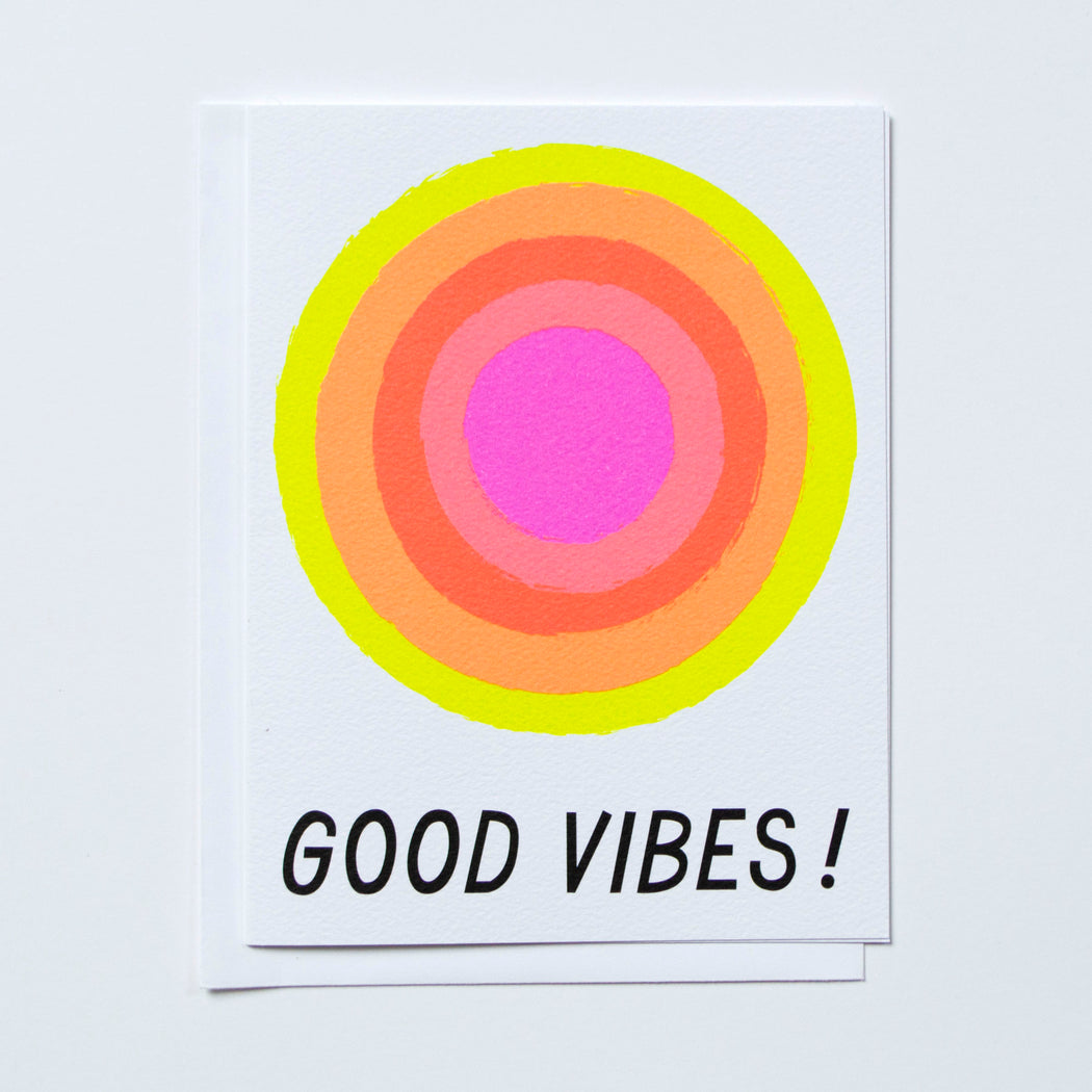 Good Vibes text with vibrating neons in oranges picks yellows and purples