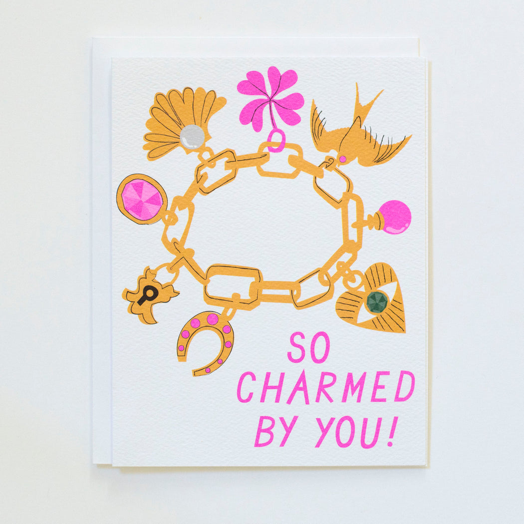 charm bracelet drawing on card text states SO Charmed By You