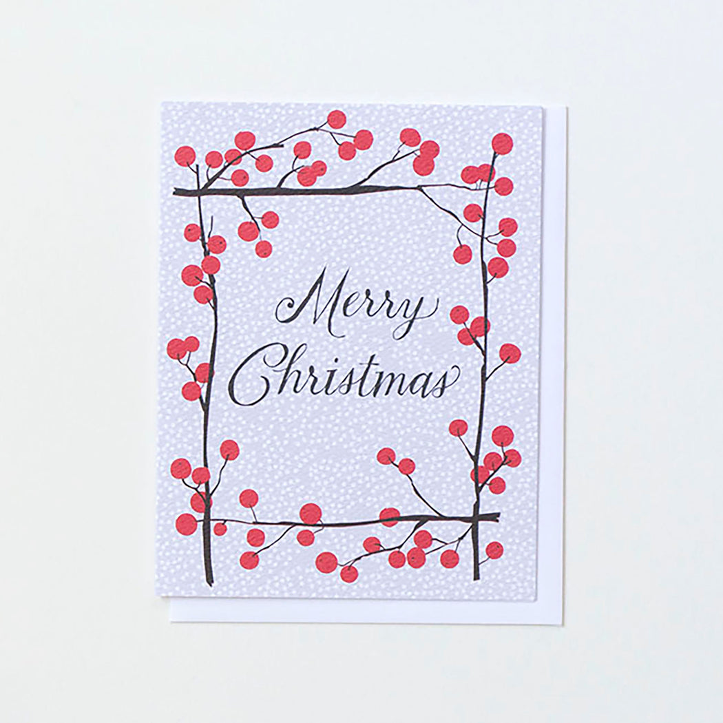 A frame of gorgeous red ilex berry branches on a Merry Christmas card from Banquet Workshop