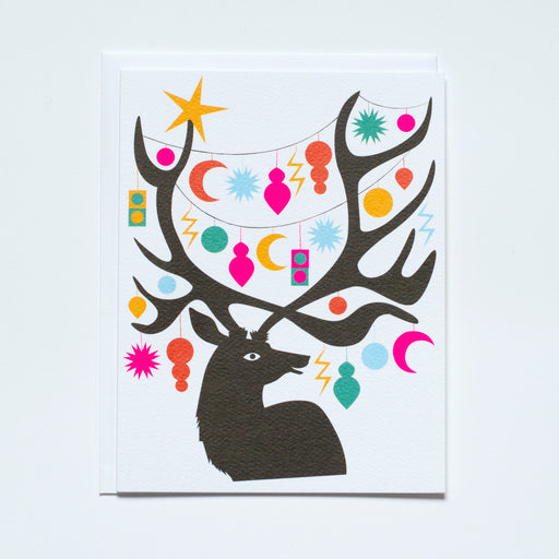 deer with large antlers filled with ornaments in all shapes and colours