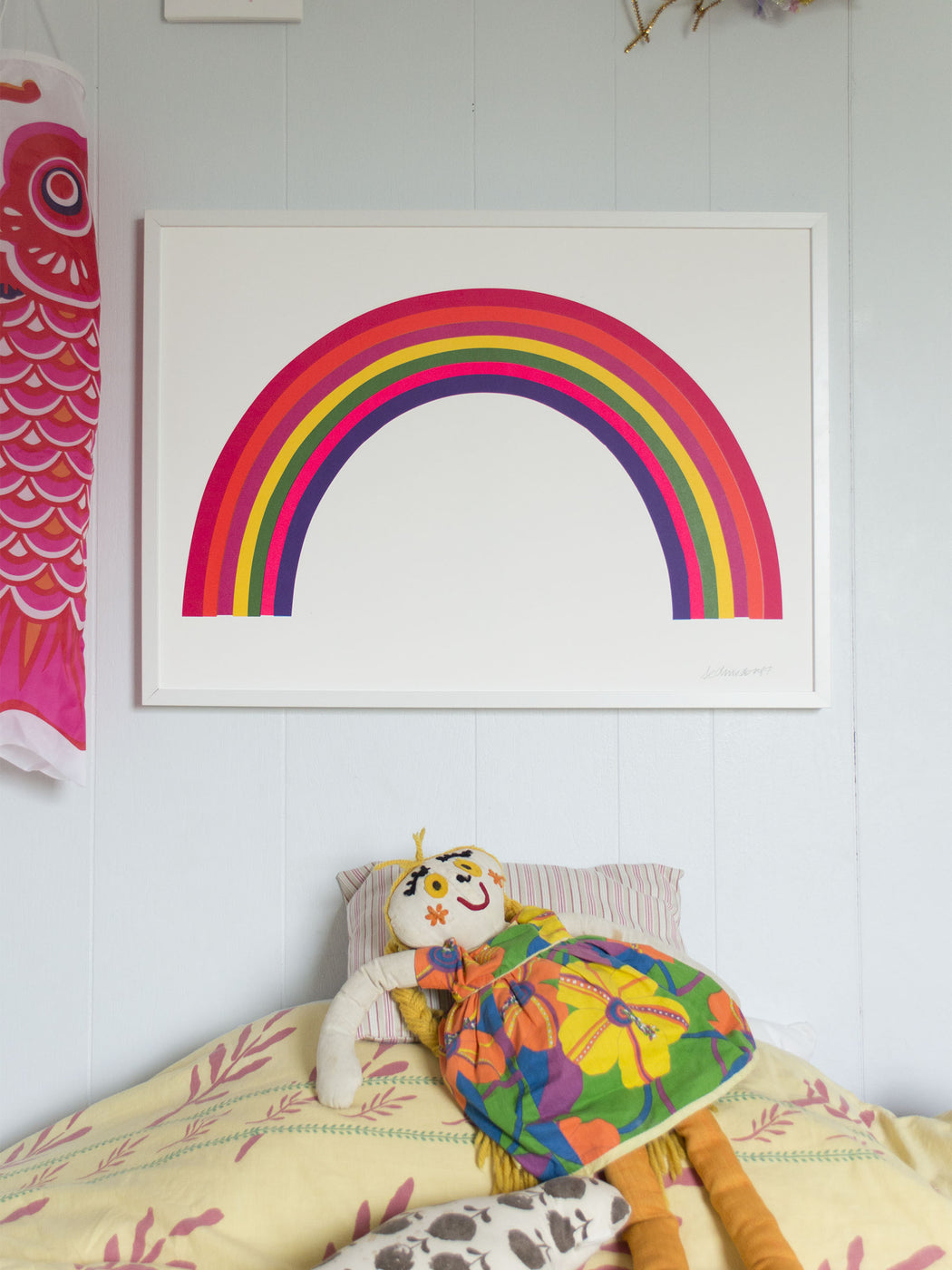 neon rainbow art print in a child's room.