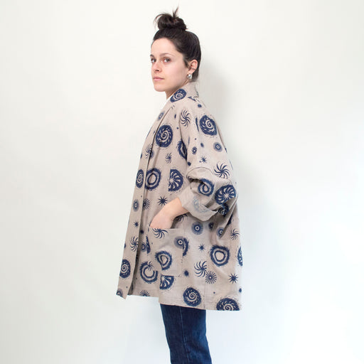 a kimono style linen jacket in natural linen with navy fireworks