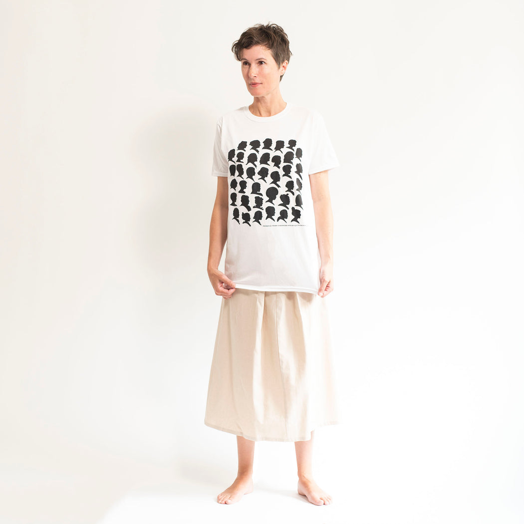 Styled shot of a white t shirt printed with the silhouettes of well know activists and feminists