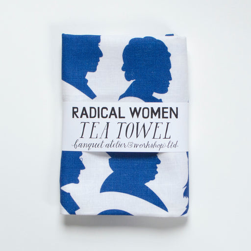 Electric blue silhouettes of important feminists and activists, screen printed on a line Banquet Workshop tea towel.