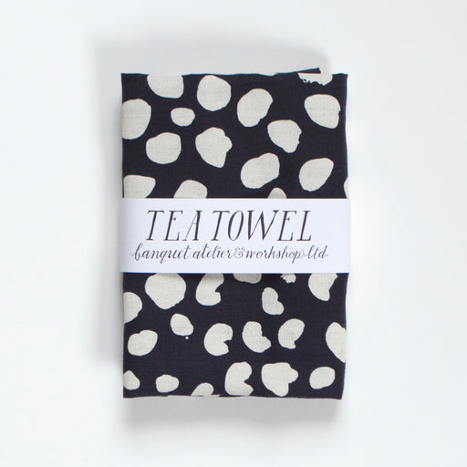 Dot and spots, leopard print inspired cream on navy all linen tea towel.