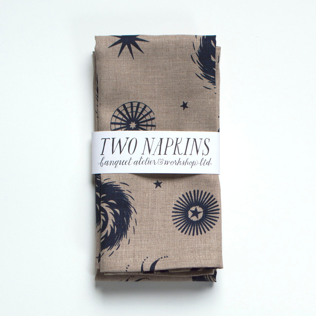 A pair of all linen napkins printed with abstracted fireworks