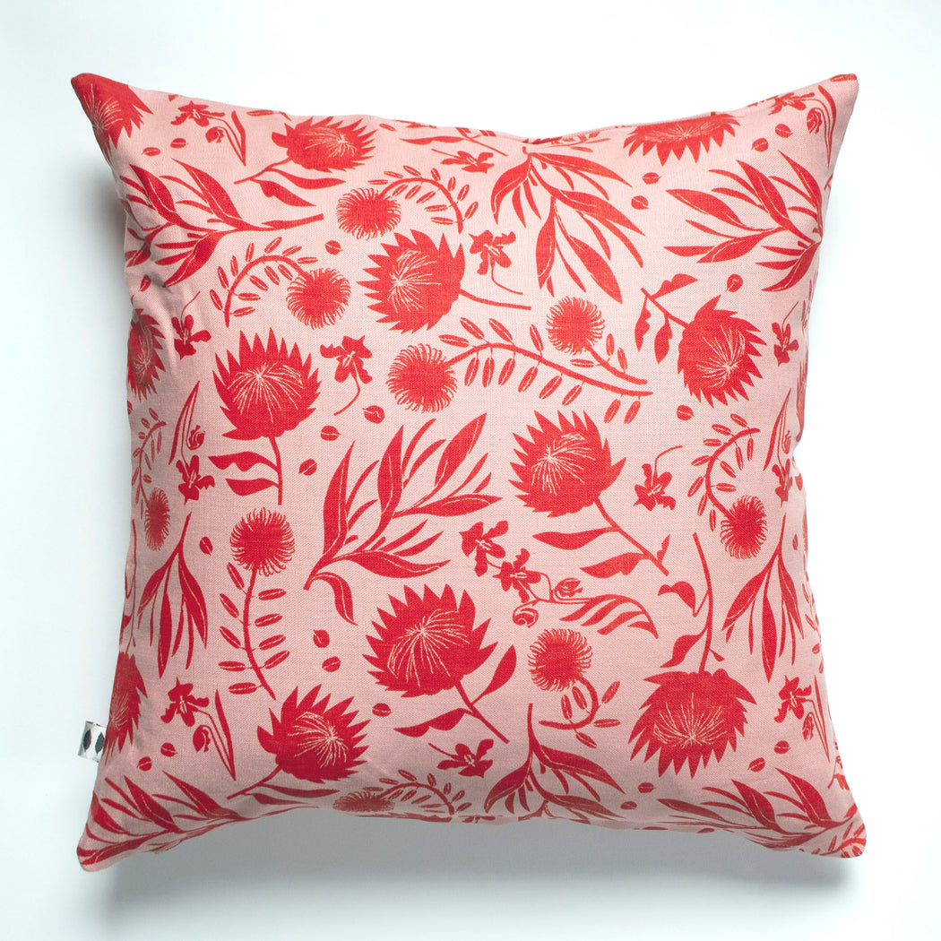 Red on blush pink floral pillow
