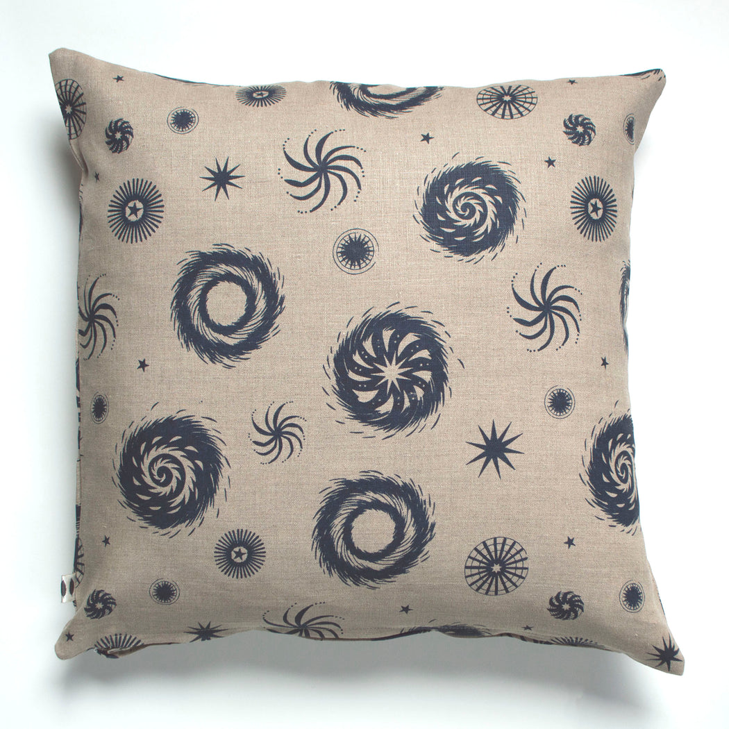 Abstracted fireworks in navy on an unbleached linen pillow