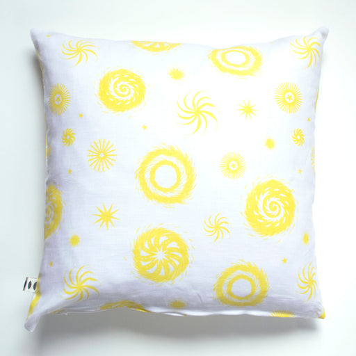 Throw pillow screen printed with lemon yellow on white abstracted fireworks repeat print