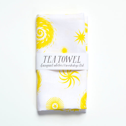 Yellow starburst explosions based on fireworks adorn this all linen tea towel