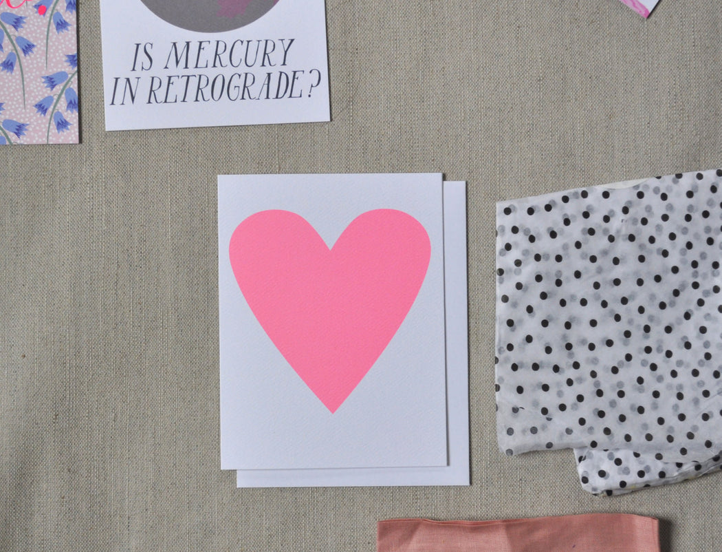 "Baby pink heart card with other stationery including Is Mercury in Retrograde"" note card."