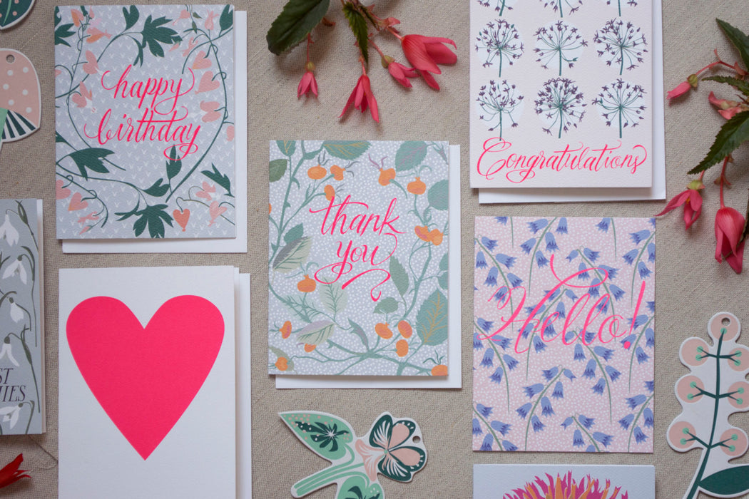 Styled note cards including Banquet Workshop's famous neon heart card