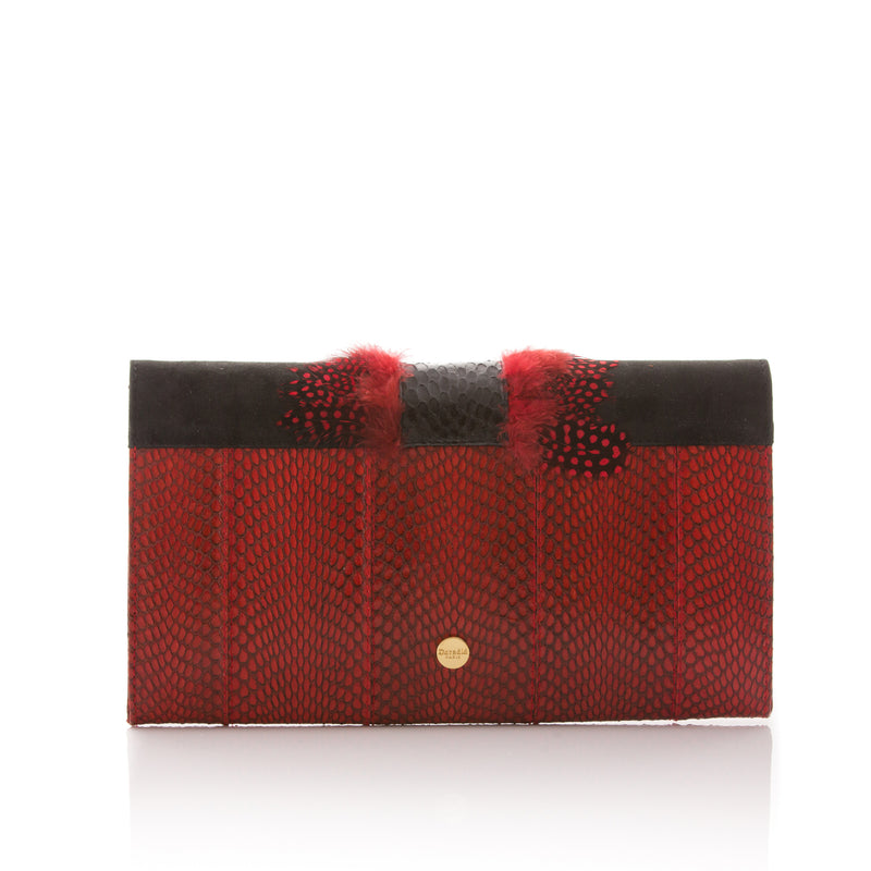 COCOTTE clutch red and black with a shoulder strap.