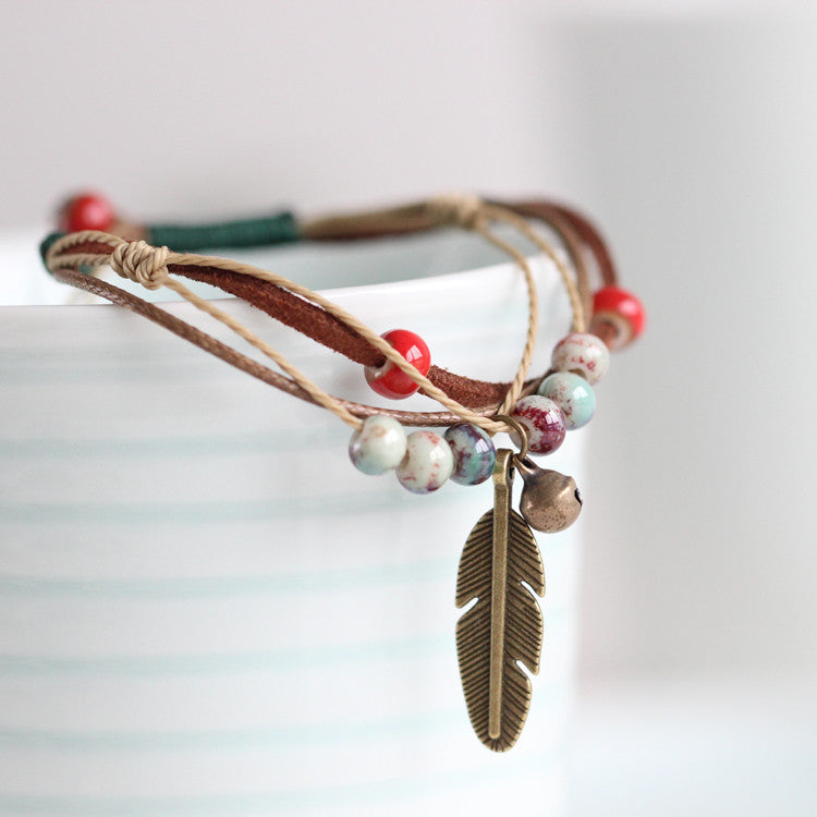 Handmade Original Adjustable Rope Bracelet, Bronze Feather Porcelain Bead