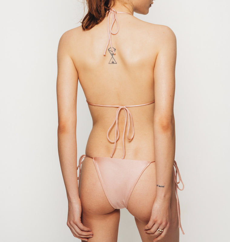 The Wanderlast Cantik swimwear bellini string along bikini top in shiny pink back