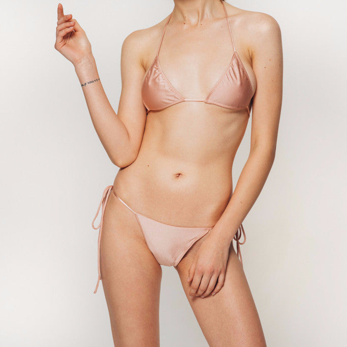The Wanderlast Cantik swimwear bellini string along bikini top in shiny pink