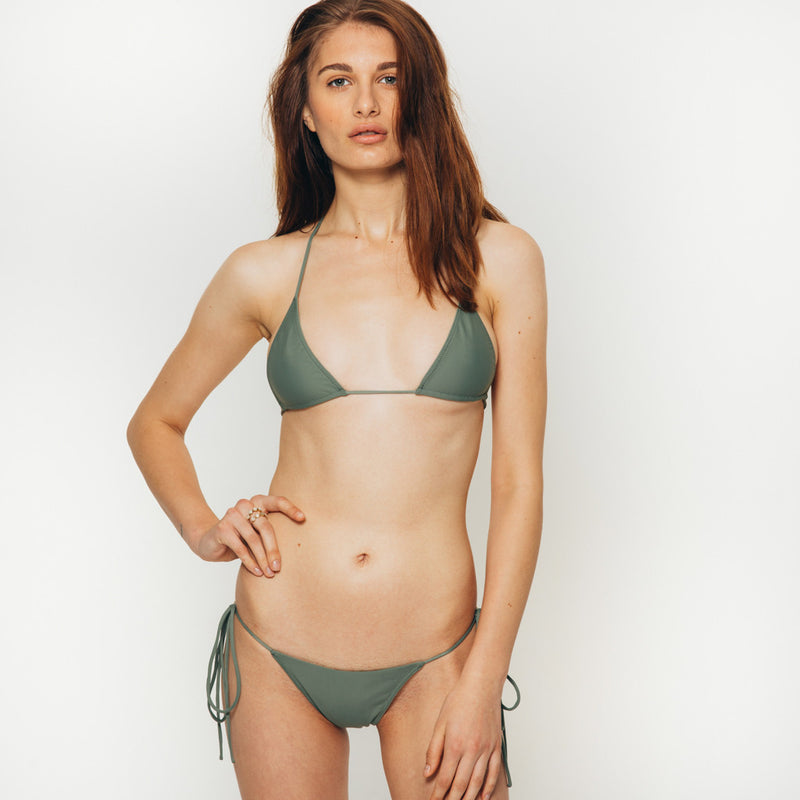 The Wanderlast Cantik swimwear string along bikini bottom in  khaki green army front