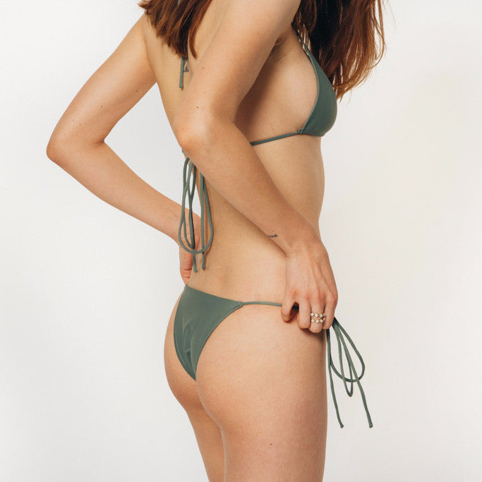 The Wanderlast Cantik swimwear string along bikini bottom in  khaki green army side