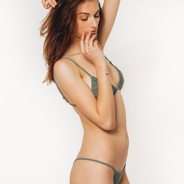 The Wanderlast Cantik swimwear phoenix bikini bottom in green khaki army side details