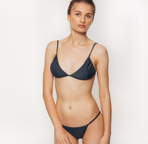 The Wanderlast Cantik swimwear phoenix bikini bottom in dark grey slate front