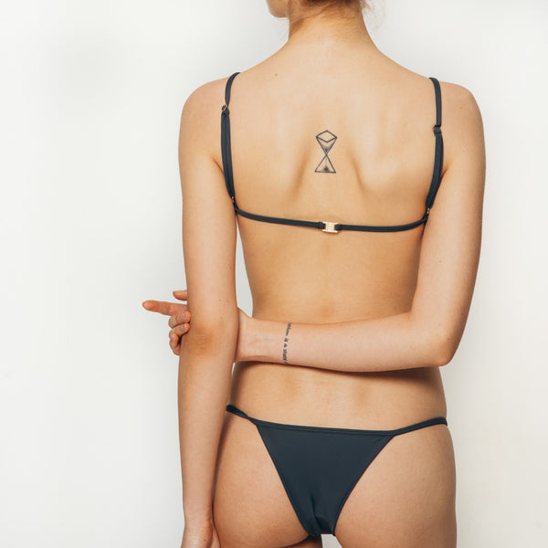The Wanderlast Cantik swimwear phoenix bikini bottom in dark grey slate back