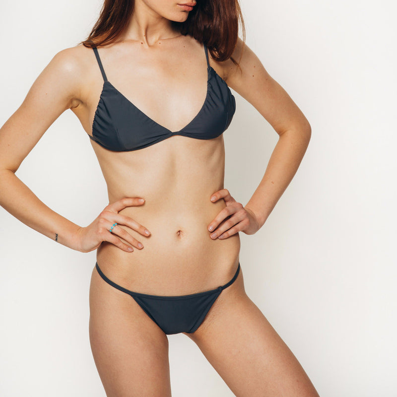 The Wanderlast Cantik swimwear phoenix bikini bottom in dark grey slate side