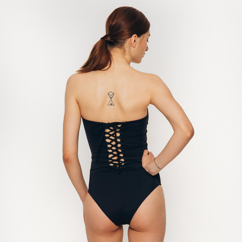 Palm swimwear one piece laced up body suit swimsuit in black strapless back view