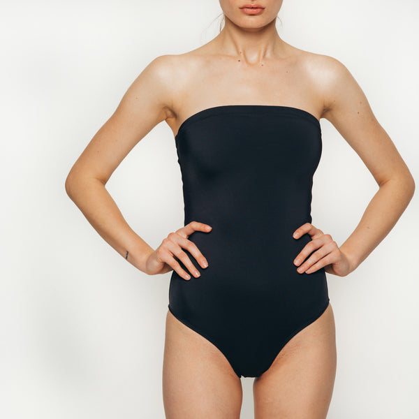 Palm swimwear one piece laced up body suit swimsuit in black strapless front view