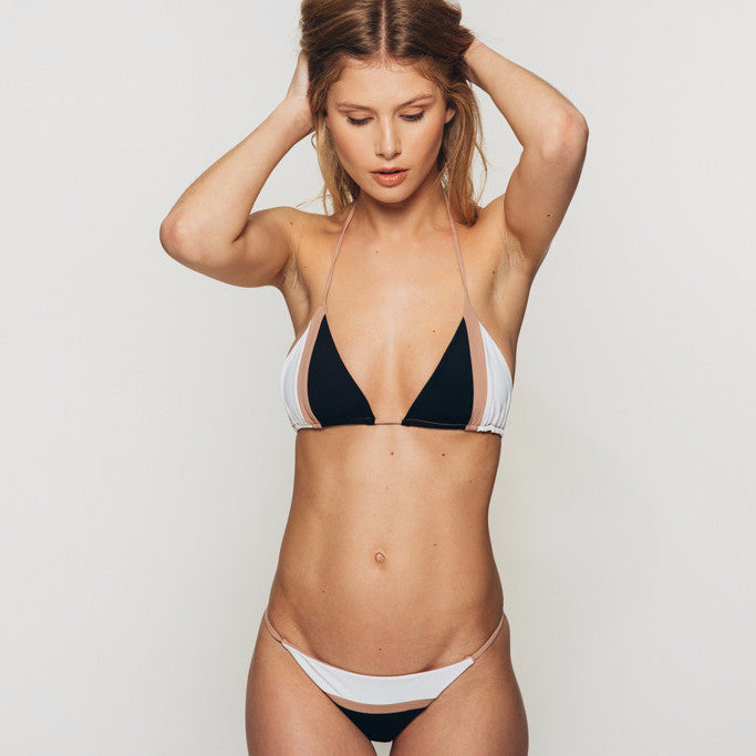 The Wanderlast Djunah sunset bottom in black and white beige bikini close up