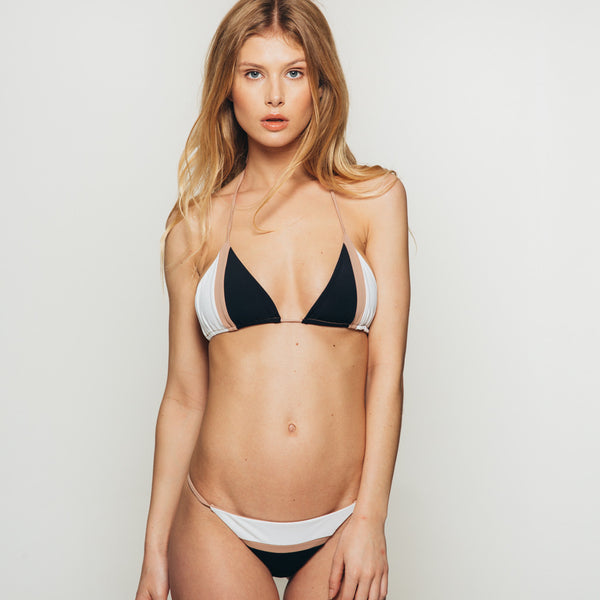 The Wanderlast Djunah sunset bottom in black and white beige bikini