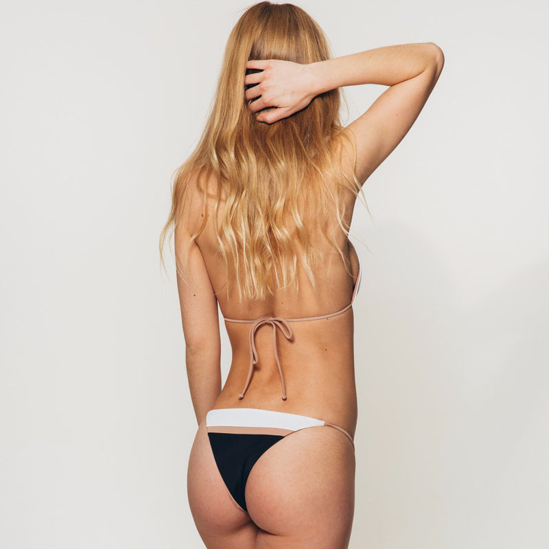 The Wanderlast Djunah sunset bottom in black and white beige bikini back