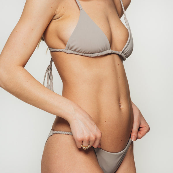 The Wanderlast djunah swimwear lina bikini top in stone grey close up