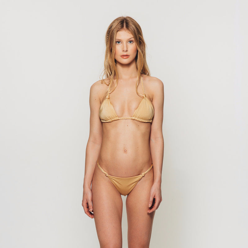 The Wanderlast djunah swimwear sunday bottom in gold bikini swimsuit front